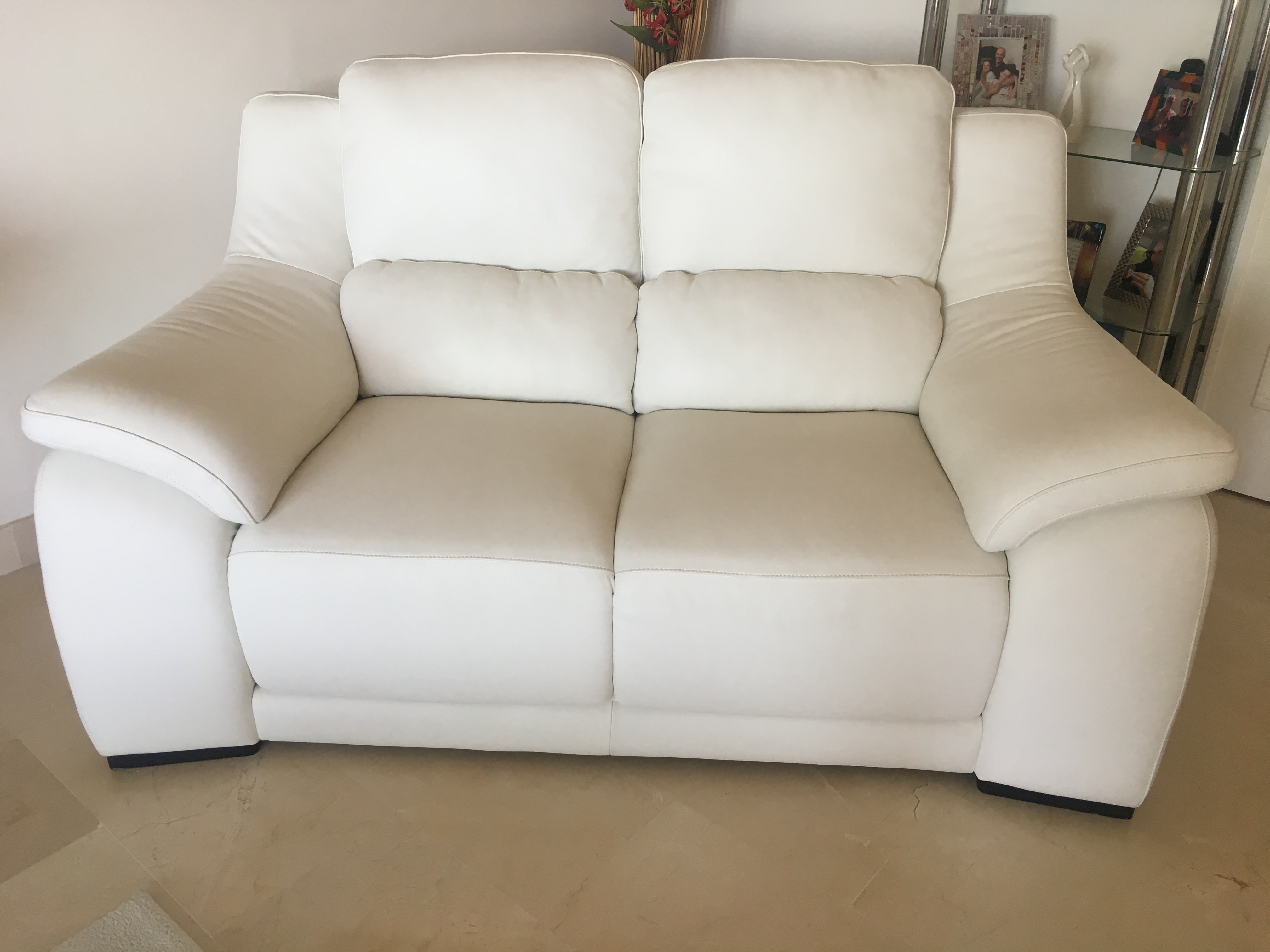 For sale: 2 seater Italian white leather sofa. As new ...