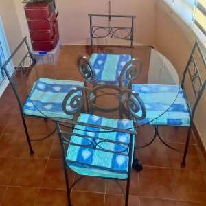 For sale: Patio Dining Table and Chairs.