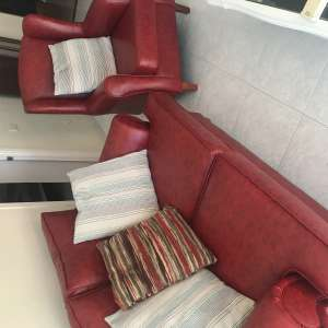 For sale: Two seater dark red settee