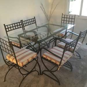 For sale: Glass top table and 6 matching chairs